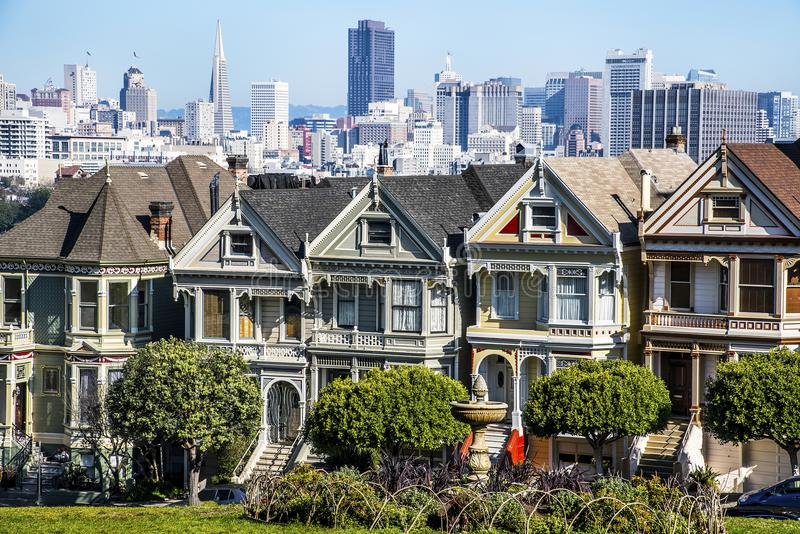 San Francisco, California, United States-circa 2014-Dancing Ladies row of cute gingerbread victorian architectural style houses royalty free stock photos