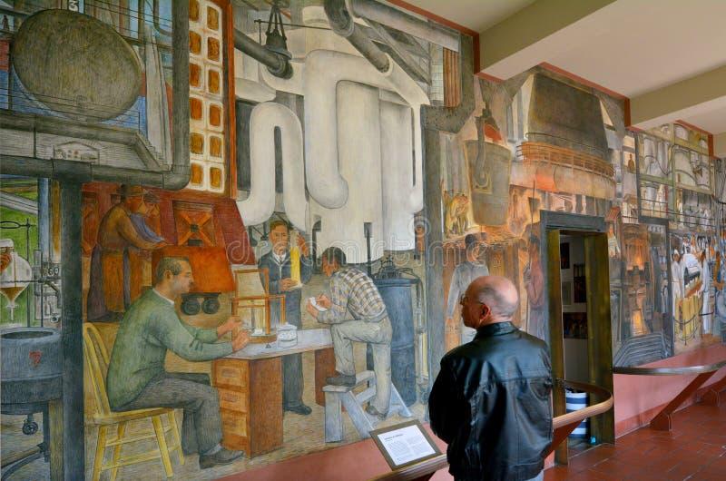 San Francisco - California United States. SAN FRANCISCO - MAY 18 2015:Visitor looks at mural at Coit Tower lobby in San Francisco California.Coit Tower listed as stock photo