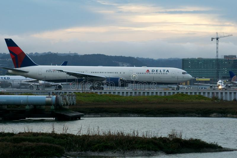 SAN FRANCISCO, CALIFORNIA, UNITED STATES - NOV 27th, 2018: A Delta Boeing 767 taxiing along the taxiway before departure. At SFO International Airport royalty free stock image