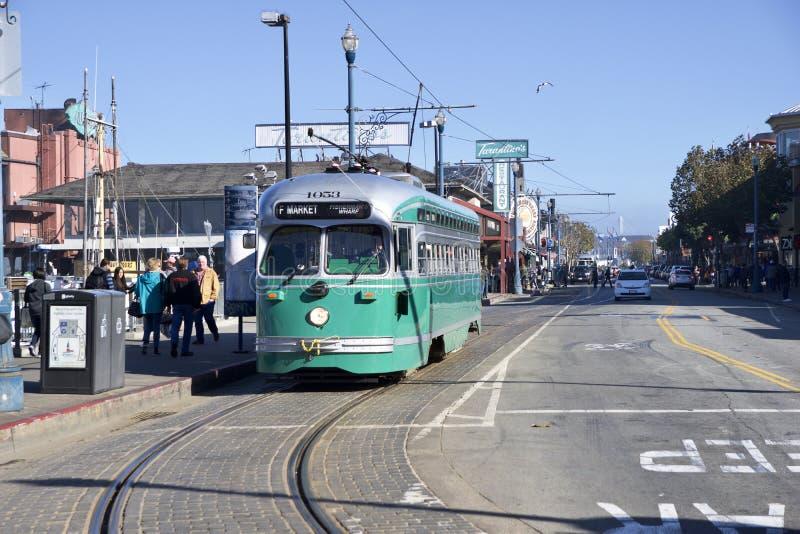 SAN FRANCISCO, CALIFORNIA, UNITED STATES - NOV 25th, 2018: F-line Antique PCC streetcar No.1053 Brooklyn at Fisherman`s. Wharf stock photography