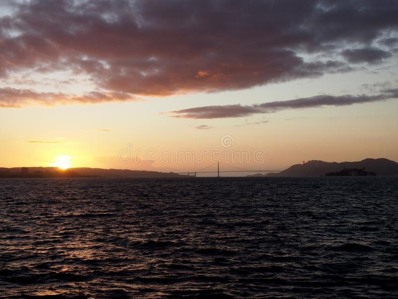 San Francisco city skyline, Golden Gate Bridge, and Alcatraz Isl royalty free stock images