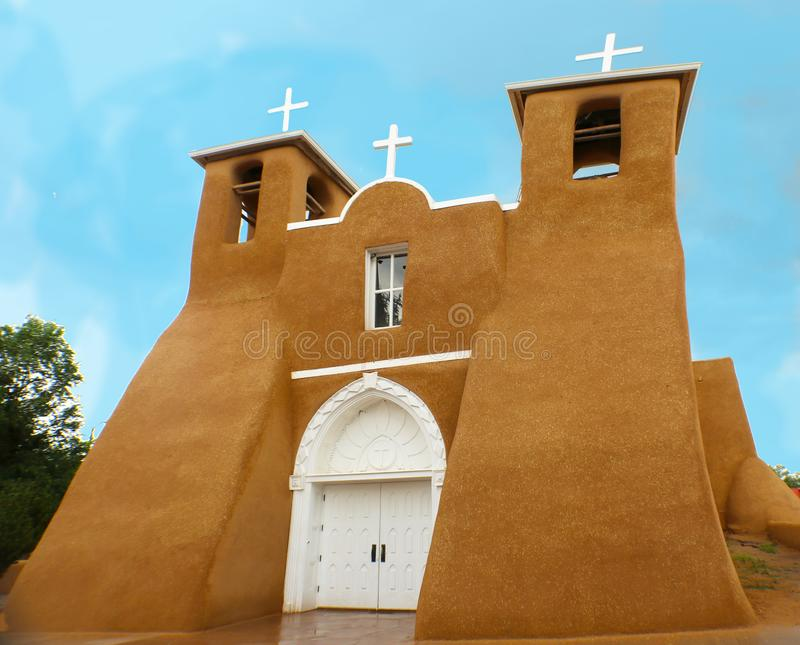 San Francisco de Asis Mission Church in rain - unique adobe architecture located in Taos New Mexico stock photo