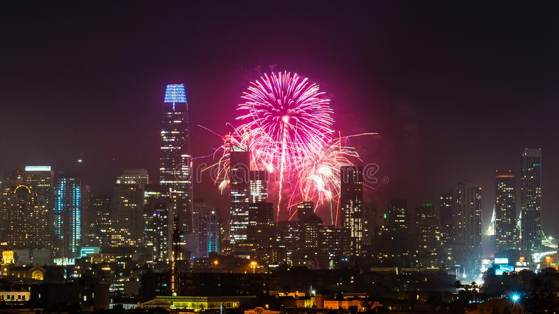 San Francisco downtown skyline visible against the New Year`s Day Fireworks Show royalty free stock photography