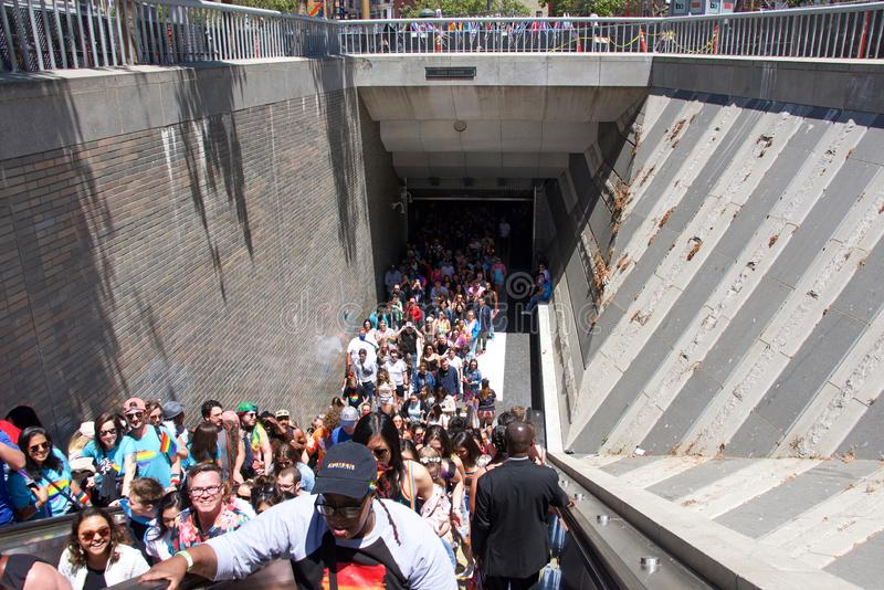 San Francisco Gay Pride Festival, bart crowded. San Francisco, CA - June 30, 2019: Hundreds of unidentified participants pouring out of BART station at Civic royalty free stock image