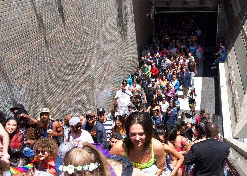 San Francisco Gay Pride Festival, bart crowded. San Francisco, CA - June 30, 2019: Hundreds of unidentified participants pouring out of BART station at Civic stock images