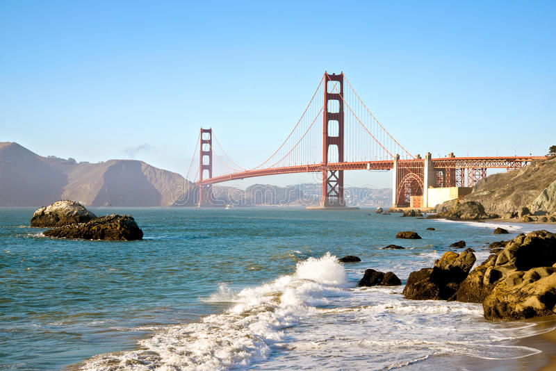 San Francisco Golden Gate Bridge from Baker Beach. With pacific Ocean surf and waves royalty free stock images