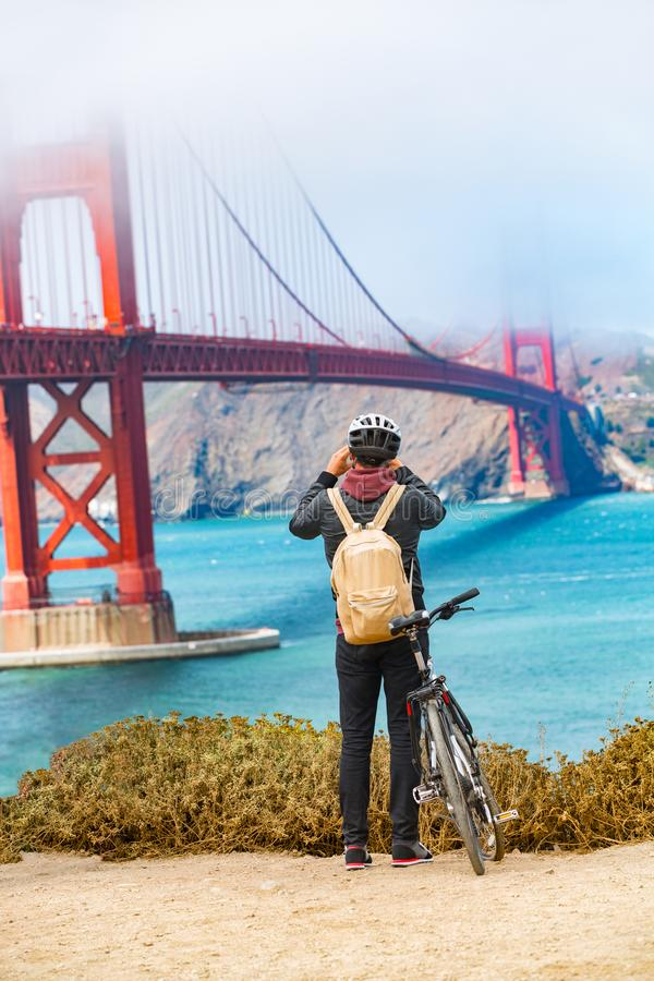 San Francisco Golden Gate Bridge biking tourist with bicycle taking pictures of view on West Coas, California, United States of stock photos