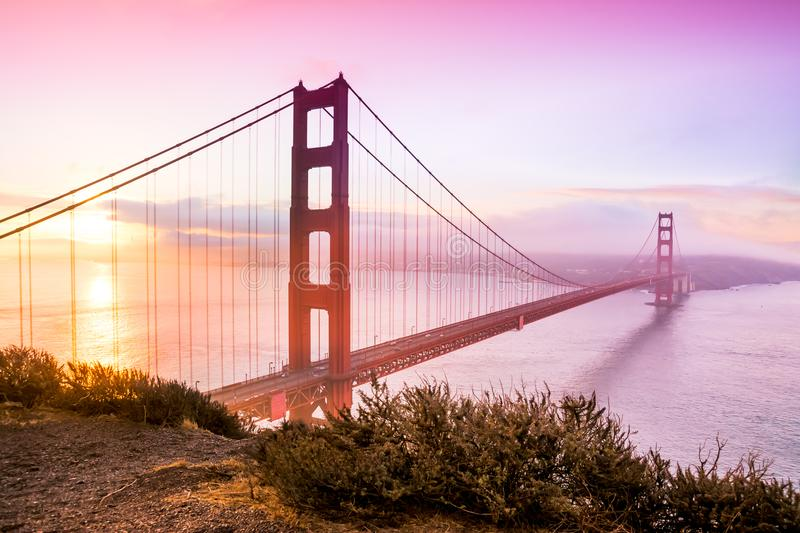 San Francisco golden gate bridge at sunrise. Panoramic view over the San Francisco Golden Bridge and bay area at down during sunrise. Photo taken from Battery