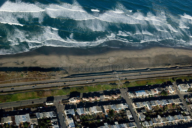 San Francisco Ocean beach from. This is ocean beach in San Francisco and Hwy 1. Also seen is parts of Golden Gate park. This photograph was taken from a cessna royalty free stock photo