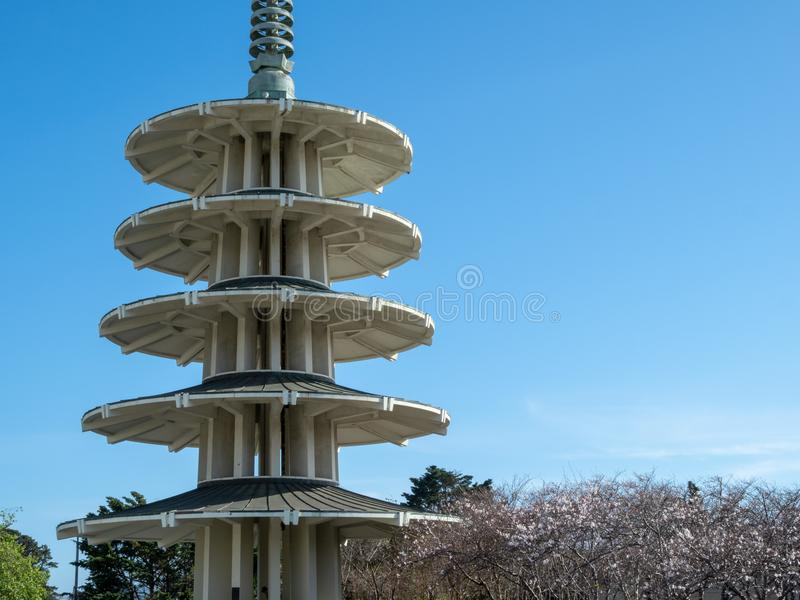 San Francisco Peace Pagoda with cherry blossom trees underneath stock image
