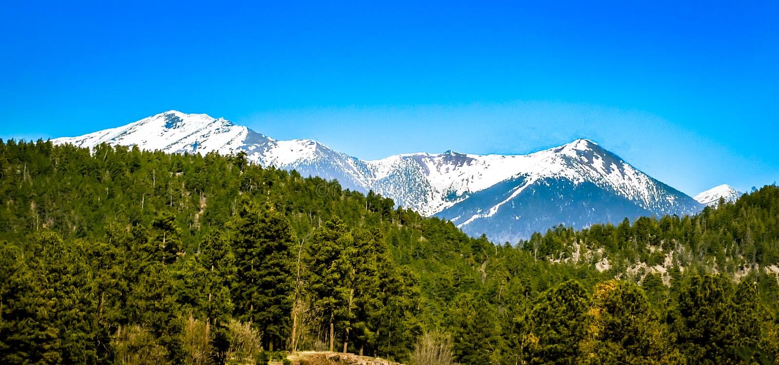 San Francisco Peaks Flagstaff Arizona. Snow covered San Francisco Peaks, situated just outside of Flagstaff Arizona, close to the South Rim of the Grand Canyon stock photography