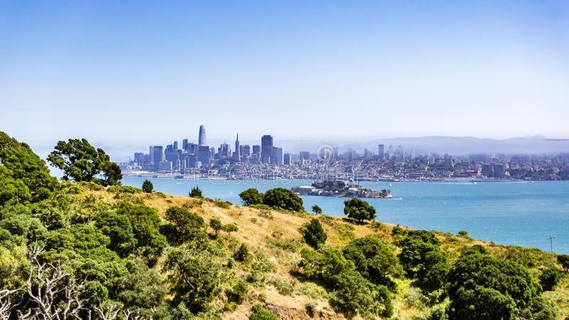 San Francisco skyline and Alcatraz Island on a sunny day, as seen from Angel Island, California royalty free stock photos