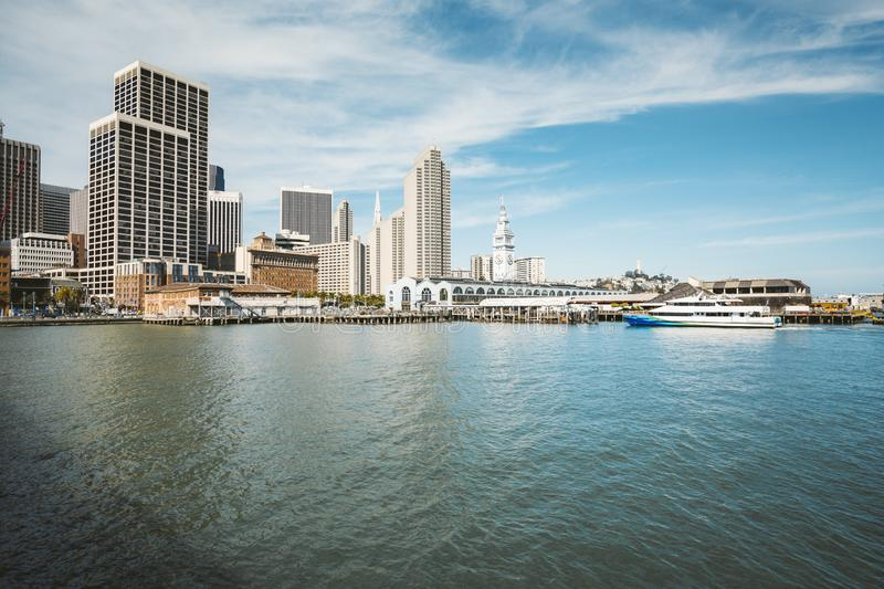 San Francisco skyline with Ferry building in summer, California, USA. Panoramic view of San Francisco skyline with historic Ferry Building at famous Embarcadero royalty free stock photos