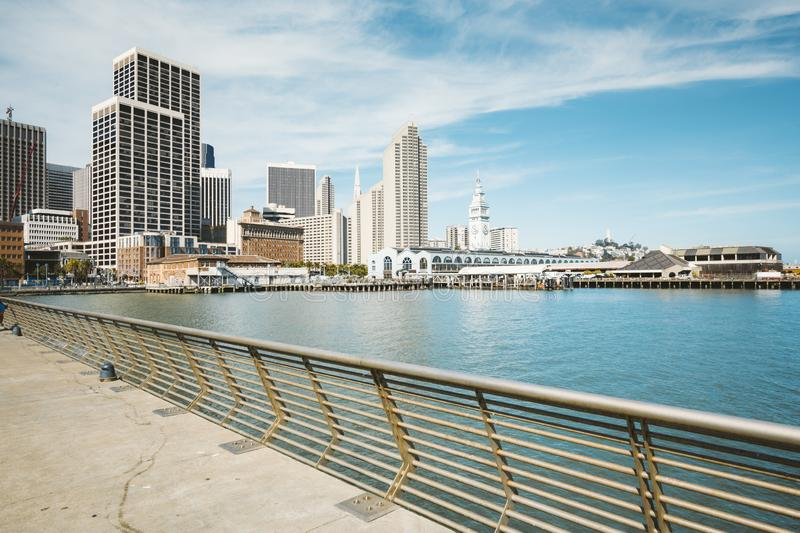 San Francisco skyline with Ferry building in summer, California, USA. Panoramic view of San Francisco skyline with historic Ferry Building at famous Embarcadero royalty free stock photography