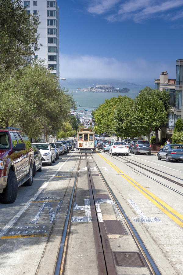 San-Francisco-United States, July 13, 2014: Authentic San-Francisco Tram Ascending Uphill With People on July 13, 2014 in royalty free stock image