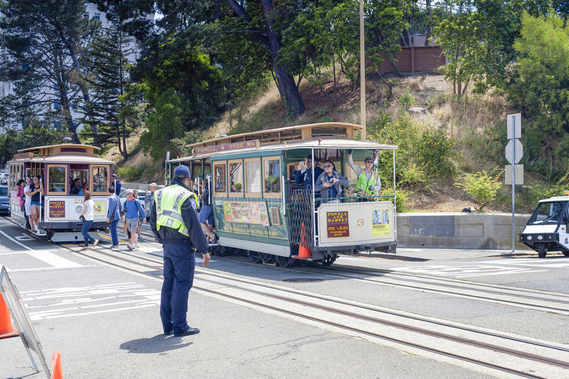 San-Francisco-United States, July 13, 2014: Authentic San-Francisco Tram Ascending Uphill With People on July 13, 2014 in royalty free stock photos