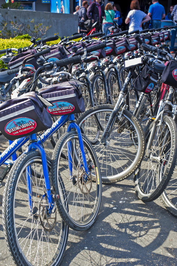 "San-Francisco-United States, July 13, 2014: Line of Plenty Public Bicycles for Leisure Activities Outdoors. 'Blazing Saddles"" in San-Francisco on stock images"