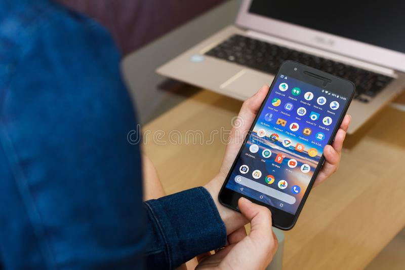 SAN FRANCISCO, US - 22 April 2019: Close up to female hands holding smartphone using Google Services and Applications, San royalty free stock photos