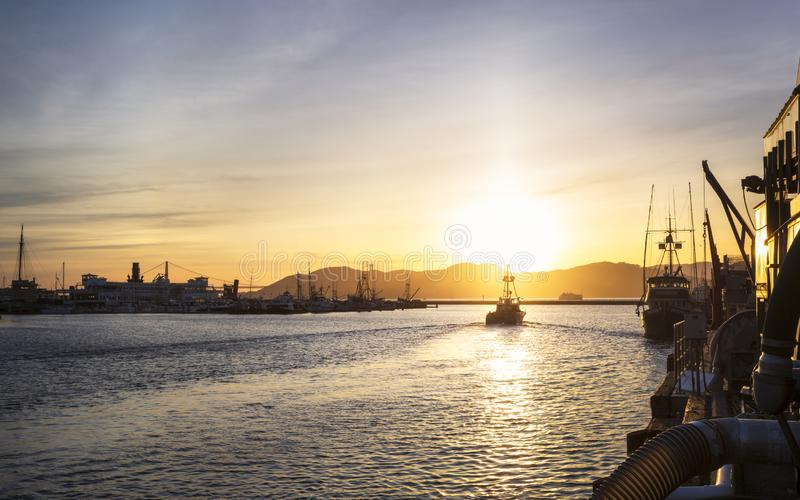 View of Golden Gate Bridge from Fishermans Wharf at sunset, San Francisco, California, United States of America, North. San Francisco, USA - June 9 2018: View of royalty free stock images