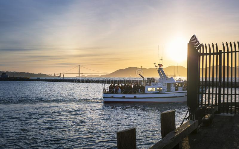 View of Golden Gate Bridge from Fishermans Wharf at sunset, San Francisco, California, United States of America, North. San Francisco, USA - June 9 2018: View of stock photo