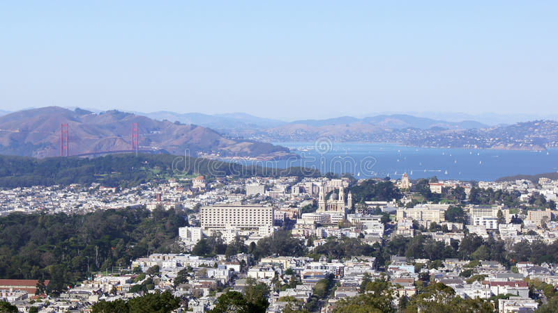 SAN FRANCISCO, USA - OCTOBER 4th, 2014: Golden Gate Bridge with SF city in the background, seen from Twin Peaks royalty free stock photography