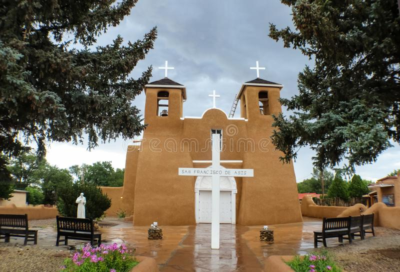 San Franciso De Asis Mission Church and courtyard on a rainy day in Taos New Mexico USA royalty free stock photography