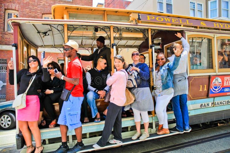 San Fransisco wagonu kolei linowej Szczęśliwi pasażery obrazy royalty free