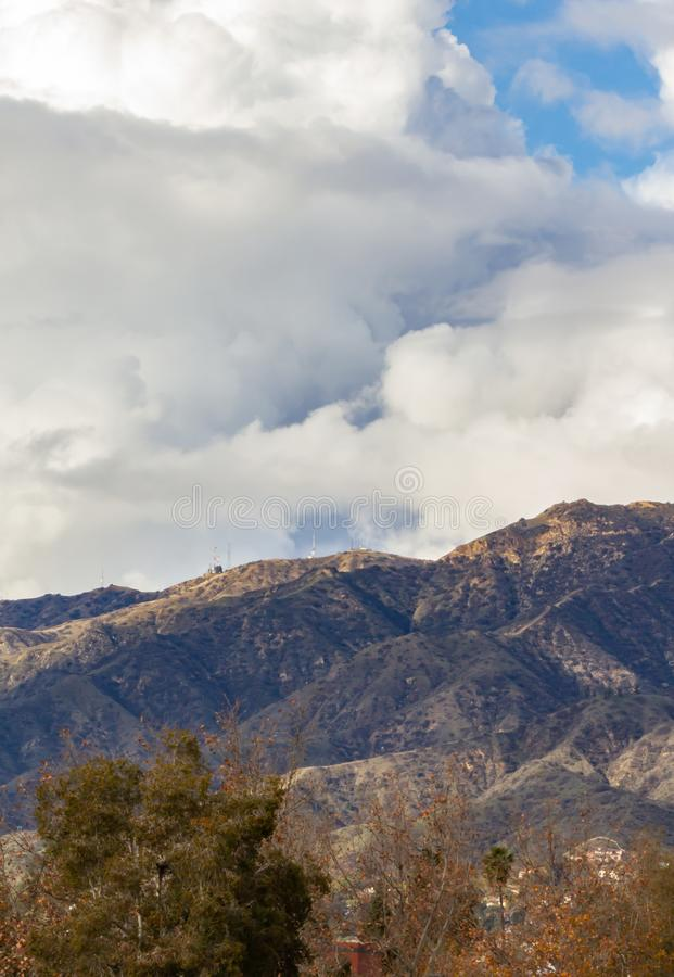 San gabriel mountains with large white dense cloud in blue sky. After a storm stock photo