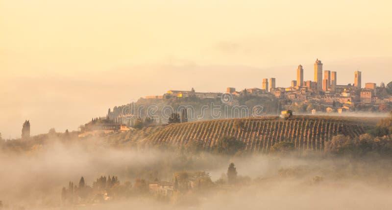 San Gimignano at the crack of Dawn. San Gimignano in the morning mist stock photos