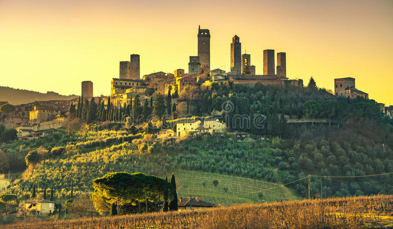 San Gimignano medieval town towers skyline and landscape. Tuscan. San Gimignano medieval town towers skyline and countryside landscape panorama on sunset royalty free stock photo