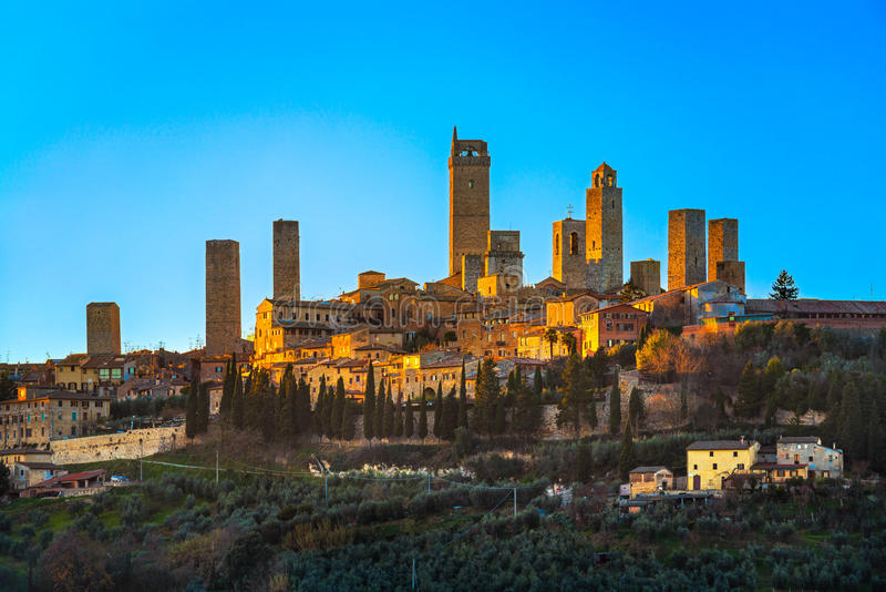 San Gimignano town skyline and medieval towers sunset. Tuscany, stock photo