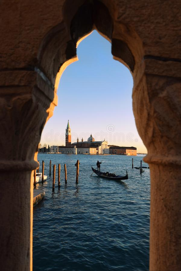 San Giorgio Maggiore church and gondolier, Venice. View of the basilica San Giorgio Maggiore 16th-century benedictine church on the island of the same name in royalty free stock image