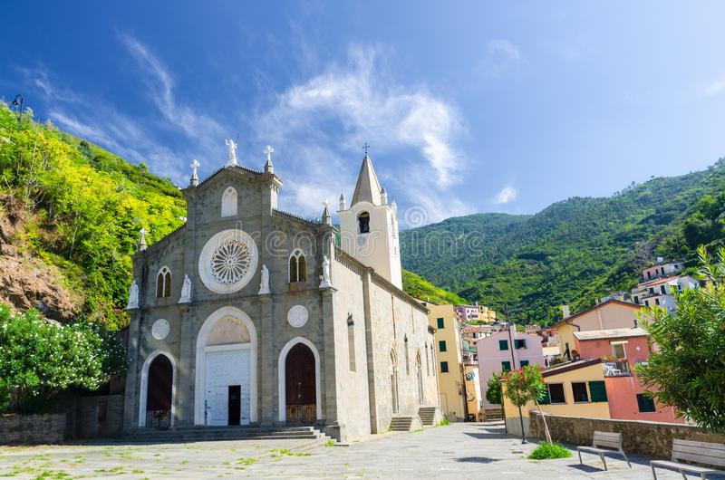 San Giovanni Battista catholic church in the valley of Riomaggiore traditional typical Italian village in National park Cinque Ter stock images