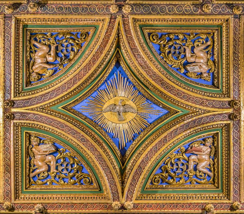 Dove of the Holy Spirit carved in the vault of the Church of San Girolamo della Carità in Rome, Italy. San Girolamo della Carità is a church in Rome royalty free stock photo