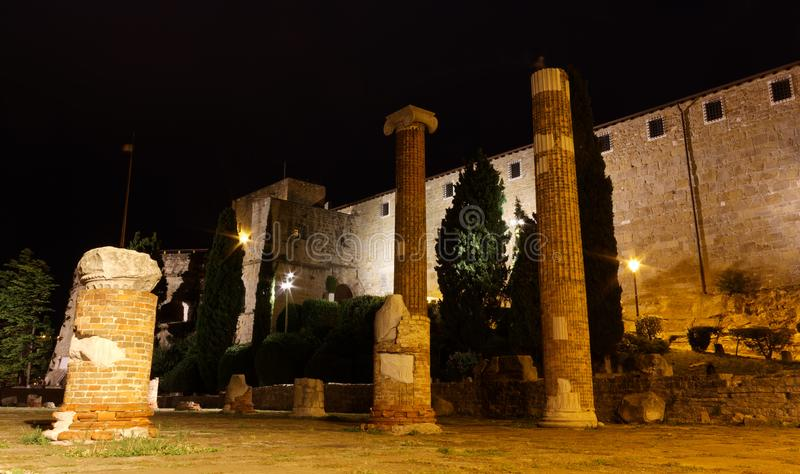 San Giusto Castle and Roman Ruins in Trieste at Night. Night view of San Giusto castle and the roman forum ruins in Trieste, Italy royalty free stock images