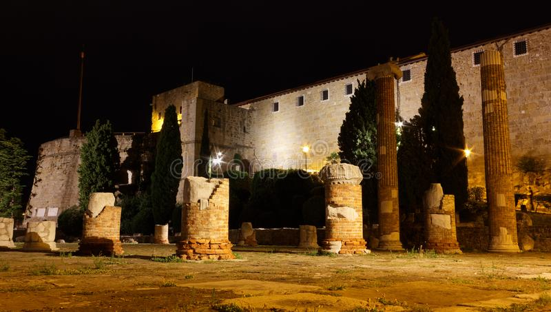 San Giusto Castle and Roman Ruins in Trieste at Night. Night view of San Giusto castle and the roman forum ruins in Trieste, Italy royalty free stock photos