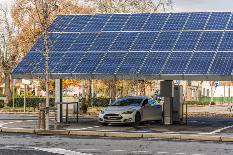 SAN ILDEFONSO, SEGOVIA, SPAIN - OCTOBER 24, 2018: Car charging station for self-sufficient and first photovoltaic panels in Europe. Car charging station for self stock image