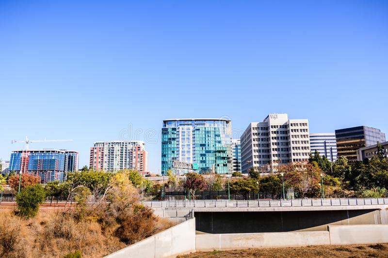 San Jose`s downtown skyline as seen from the shoreline of Guadal. Upe river on a sunny fall day; Silicon Valley, California stock photo