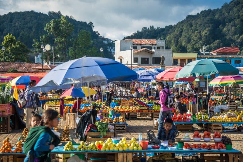 SAN JUAN CHAMULA, MEXICO - DICEMBER 2 San Juan Chamula, inhabited by indigenous Tzotzil Maya people, traditional market, selling royalty free stock photography