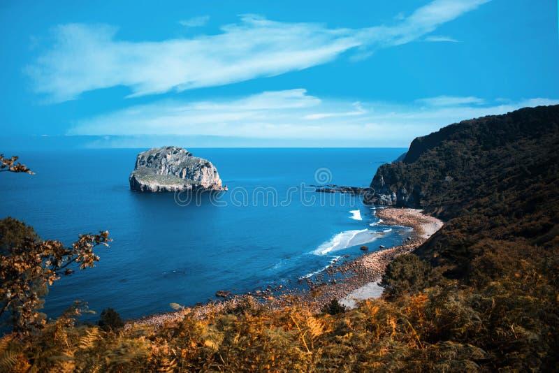 San Juan de Gaztelugatxe beach rock and cliffs stock photo