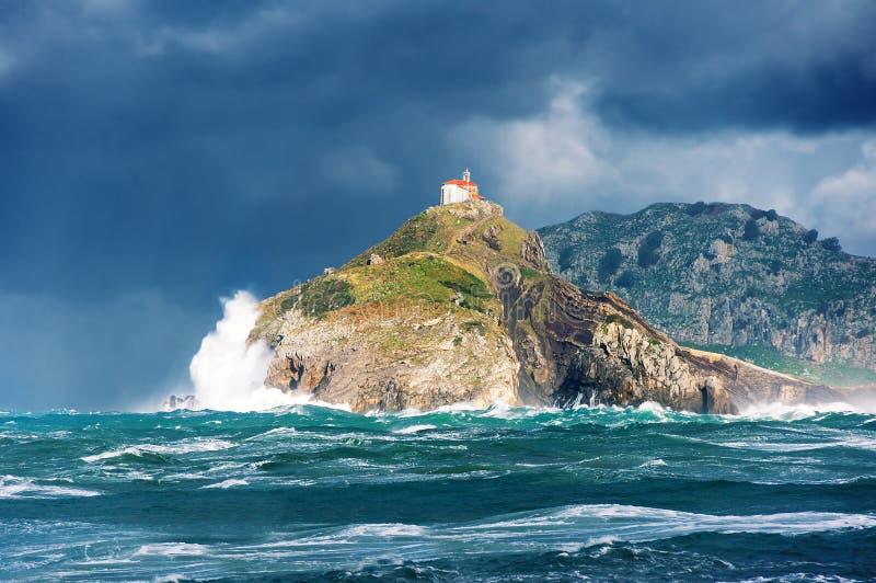 San juan de gaztelugatxe with rough sea royalty free stock photography