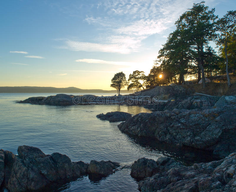 San Juan Islands Sunset with camp royalty free stock images