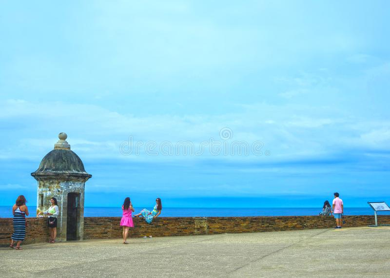San Juan, Puerto Rico - May 08, 2016: The people making photos at large outer wall with sentry box of fort San Cristobal royalty free stock photos