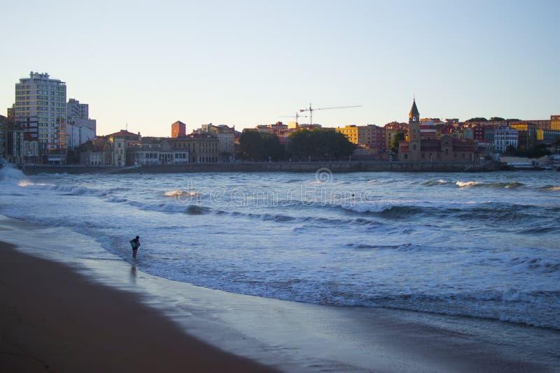 San Lorenzo beach in Gijon, Asturias, Spain, with San Pedro`s Church at the background.  royalty free stock images