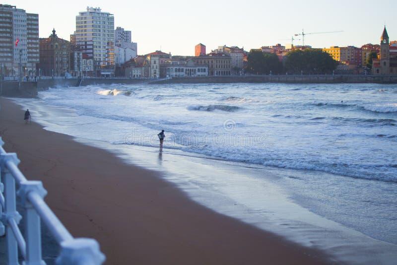 San Lorenzo beach in Gijon, Asturias, Spain, with San Pedro`s Church at the background.  royalty free stock photo