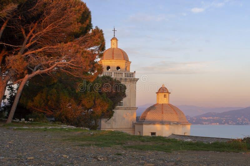 San Lorenzo bell tower and dome, Portovenere, Liguria, ITaly. Beautiful winter evening sunset. stock photos