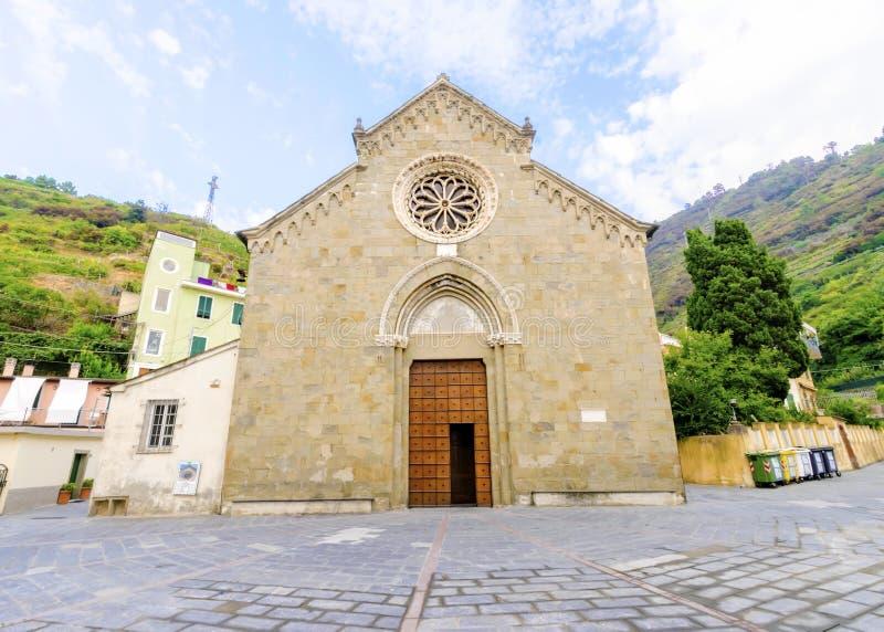 San Lorenzo church, Manarola, Cinque Terre, Italy. Manarola town, Riomaggiore, La Spezia province, Liguria, northern Italy. View of the San Lorenzo church facade stock photography