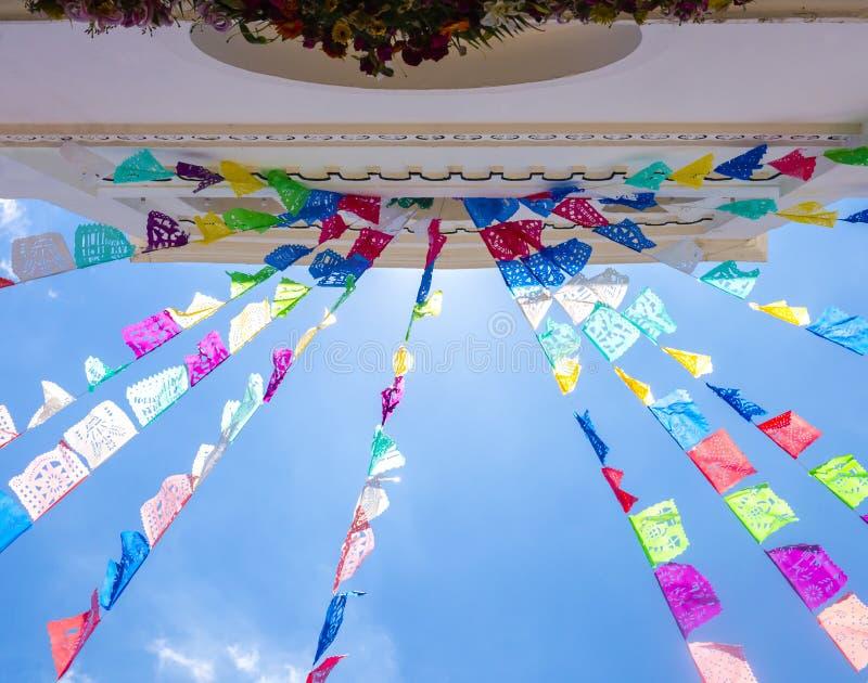 San Lorenzo church, Zinacantan, Chiapas, Mexico. Colorful prayer flags hanging on San Lorenzo church, Zinacantan, Chiapas, Mexico royalty free stock images