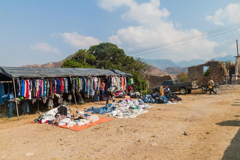 SAN MANUEL DE COLOHETE, HONDURAS - APRIL 15, 2016: Clothing market stall. There is a big market in this village twice a stock photo