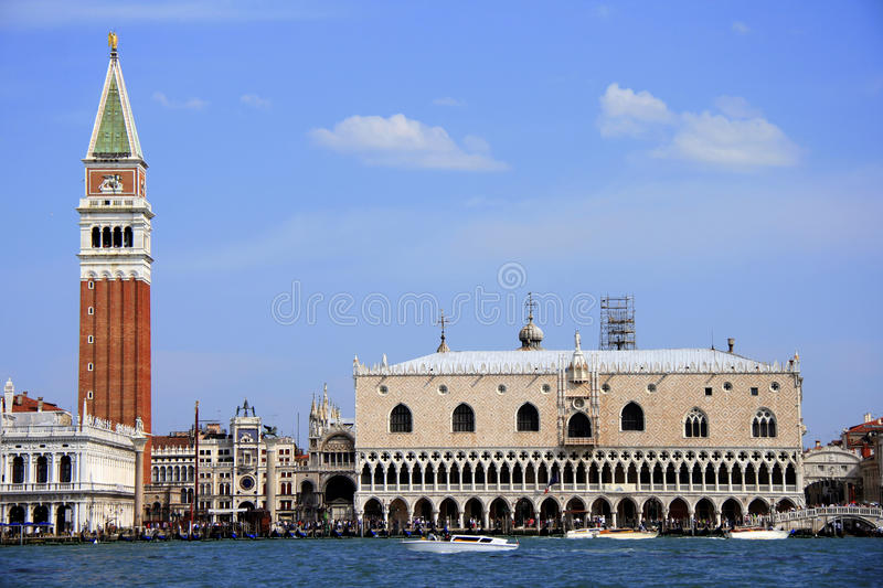 San Marco square and Doge's palace. A wide angle shot of the famous San Marco square and boat pier in Venice Italy. The bell tower and Doge Palace are two of the royalty free stock photography
